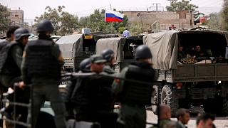 Russian flag is seen on military vehicle at entrance of Wafideen camp in Da