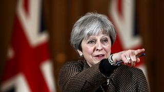 May tells Parliament UK acted in 'national interest' over Syria strikes