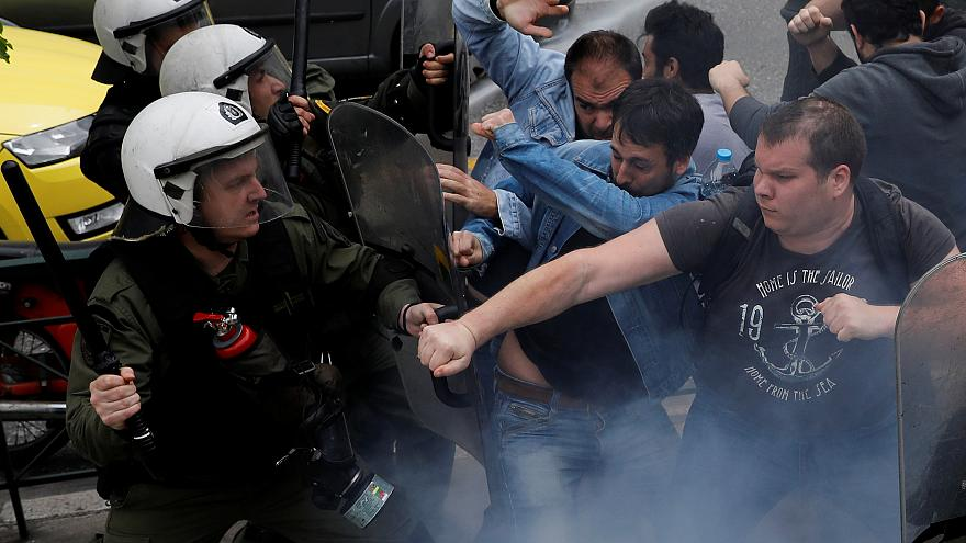 Clashes erupt as protesters try to topple Truman statue in Athens