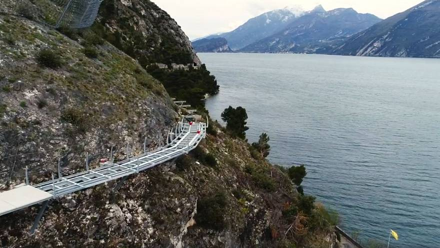 Breathtaking aerial footage shows Italy's 'floating' cycle path on Lake Garda