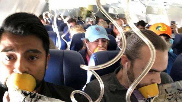 Image result for شاهد: صورٌ من داخل طائرة أمريكية أثناء هبوطها اضطرارياً في فيلادلفيا