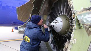 NTSB investigator is on scene examining damage to the engine of the Southwe