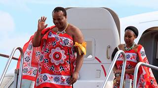 King Mswati III with one of his wives