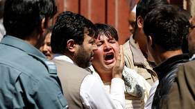 A man reacts at the site of a suicide attack in Kabul, Afghanistan 22/4/18