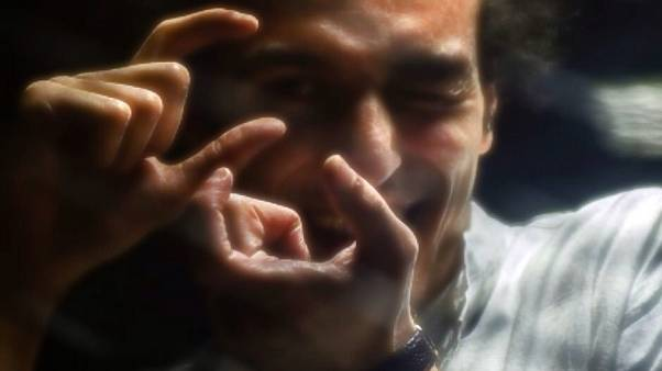 """مصر تحذر اليونسكو من تكريم المصور المسجون """"شوكان"""""""