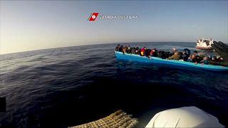 Italian coast guards rescue migrants as vessel capsizes in the Mediterranean Sea