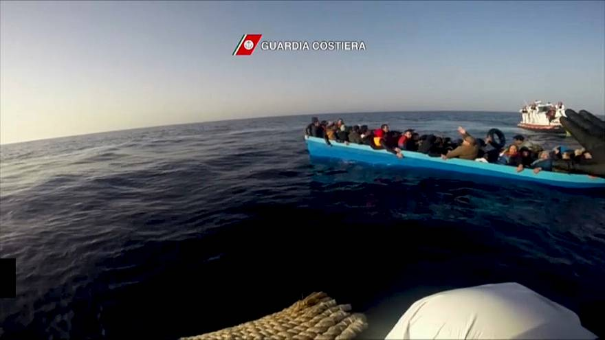Italian coast guards rescue migrants as vessel capsizes in the Mediterranean Sea
