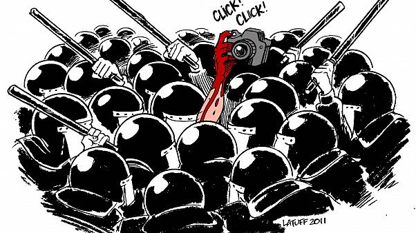 Police Day Mubarak attack against press 25Jan2011