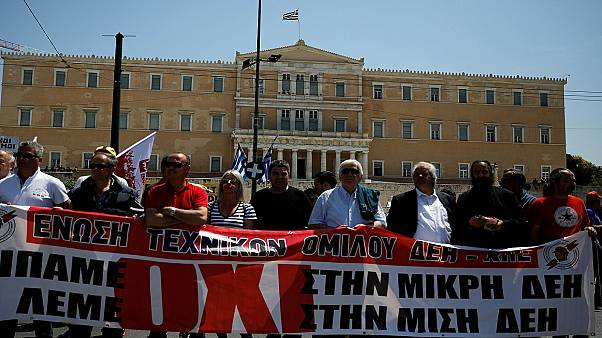Workers in front of the parliament building in Athens, Greece.