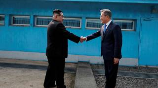 Kim Jong Un and Moon Jae-In shake hands over the border in April 2018