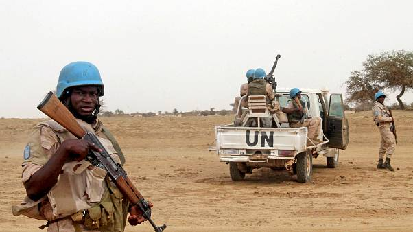FILE PHOTO: UN peacekeepers stand guard in Kouroume, Mali, in May, 2015.