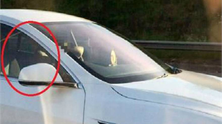 Watch: Tesla driver 'puts on autopilot and moves to passenger seat'
