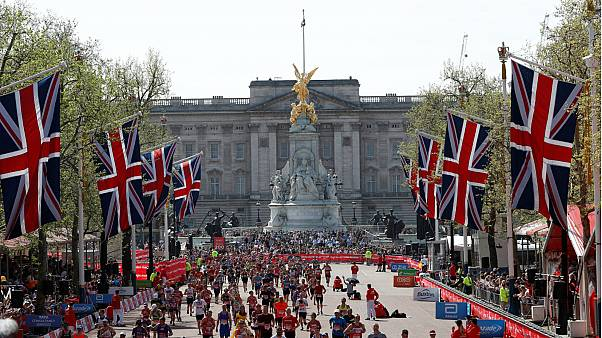Runners complete part of the London Marathon course, April 22, 2018.