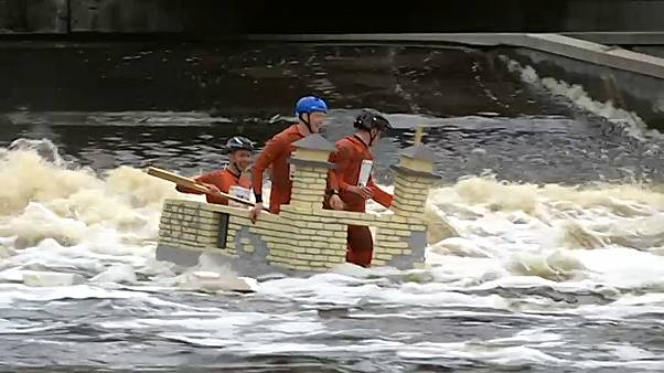 stream of floats of all shapes glide down the Fyris River