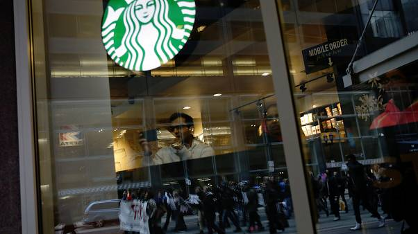 Black men arrested at Starbucks settle for $1 each and $200,000 programme