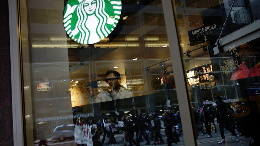 Black men arrested at Starbucks settle for $1 each and $200,000 programme