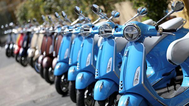 Vespa Primavera scooters parked