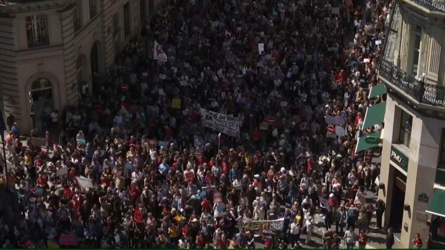 Tens of thousands protest in Paris against President Macron's economic reforms