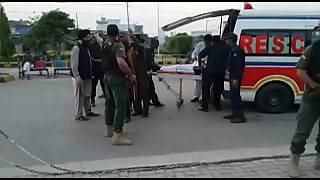 Pakistan's interior minister shot in the arm