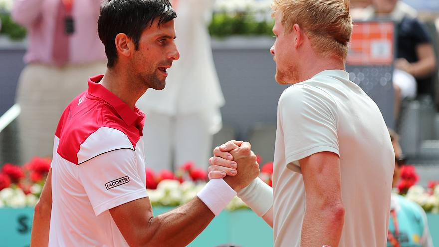 Edmumd shakes hands with Djokovic after his second round victory