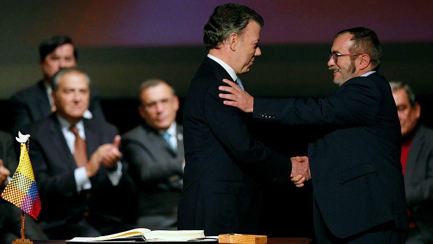 Colombian President Juan Manuel Santos and FARC leader Rodrigo Londono
