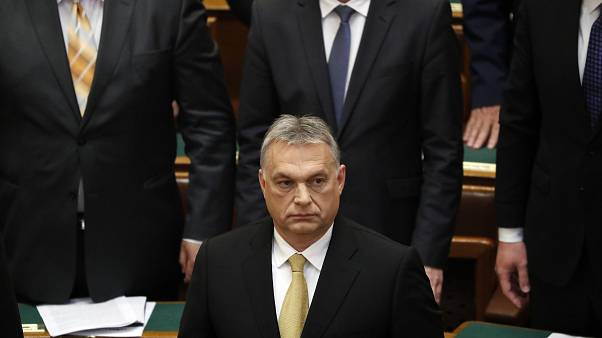Hungarian Prime Minister Viktor Orban looks on before taking the oath of of