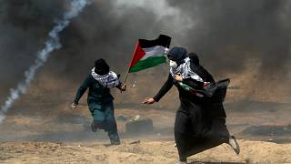 Female Palestinian protests run for cover