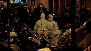 Forensic personnel at the scene of a knife attack in Paris, France May 12