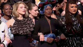 women walk the red carpet in Cannes film festival protest
