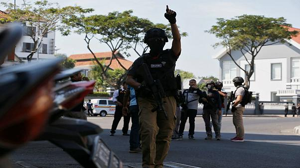 a bomb blast at police office in Surabaya