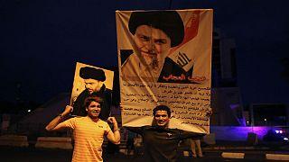 portraits of Shi'ite cleric Moqtada al-Sadr
