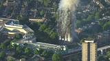 May bows to public pressure over Grenfell