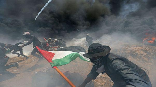 Palestinian demonstrators gather at the Israel-Gaza border