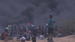 Gazans burn tyres in the hope smoke will protect them from Israeli snipers.