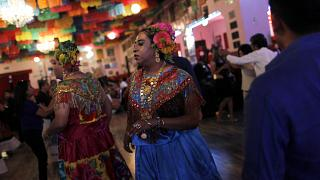 """A """"muxe"""", wearing a traditional Zapotec woman's costume, dances during a tr"""