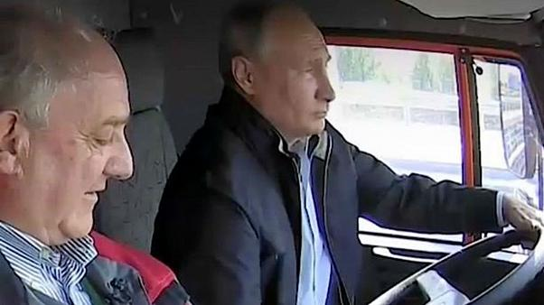 Putin drives truck across new Russia-Crimea bridge