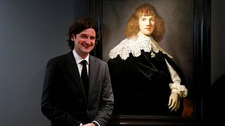 Art dealer Jan Six with the painting he says is by Rembrandt