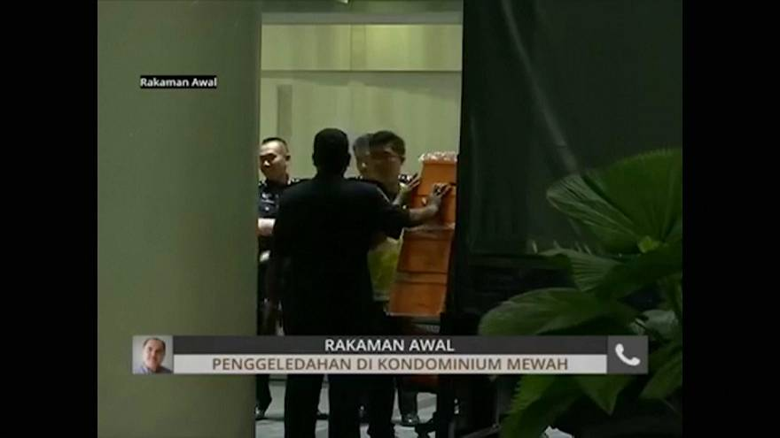 Malaysian police seize luxury goods in the raids