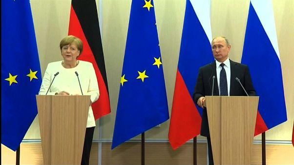 Merkel y Putin obligados a entenderse a pesar de sus diferencias