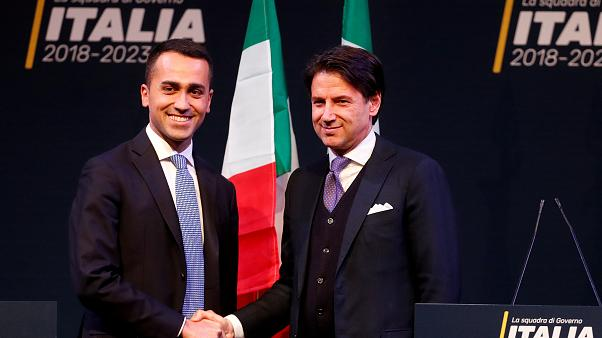 5-Star Movement leader Di Maio shakes hands with Giuseppe Conte