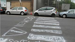 Activists paint their own pedestrian crossing on deadly Brussels street