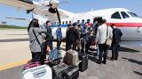 South Korean journalists board a plane for Pyongyang