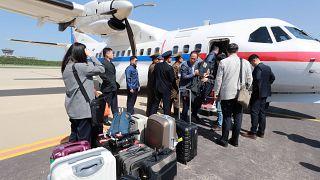 South Korean journalists board a plane for Pyongyang