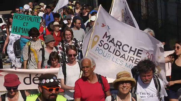Marcher pour les migrants