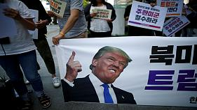 University students attend a protest against Donald Trump
