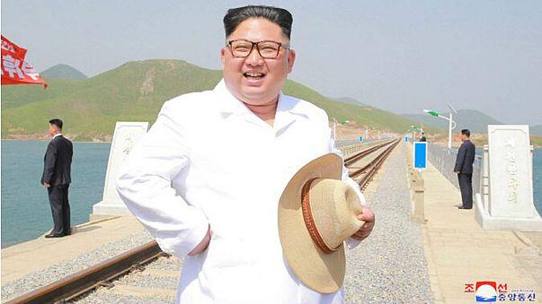Kim Jong-un wears snappy white shirt, straw hat to inspect railway
