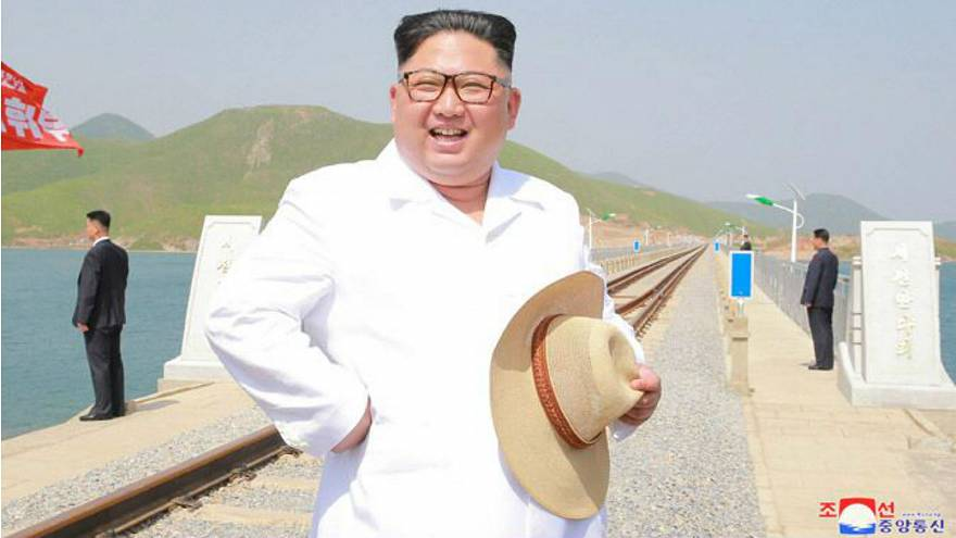 Kim Jong-un wears snappy white shirt, straw hat to inspect railway
