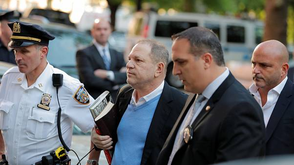 Film producer Harvey Weinstein arrives at the 1st Precinct in Manhattan