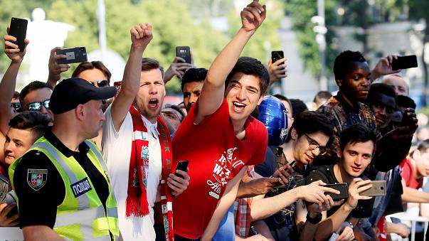 Liverpool fans greet the team arriving at their hotel