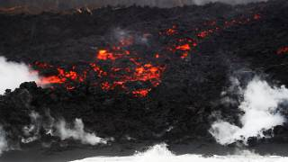 Lava pours into the ocean during the eruption of the Kilauea Volcano
